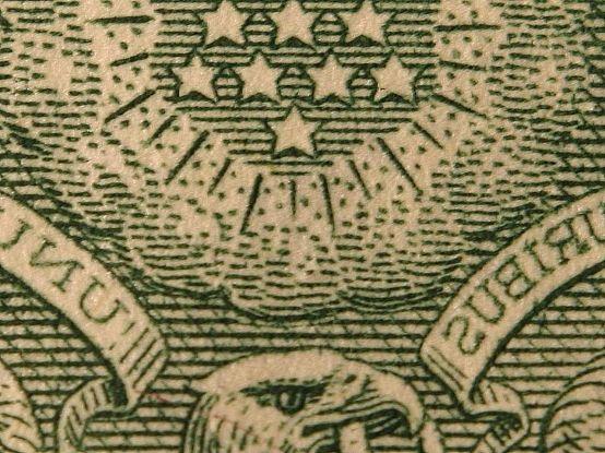 Macro_dollars_bills_money_stars.jpg
